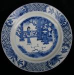 Chinese blue and white plate, Kangxi (1662-1722), decorated with a man and a woman in a fenced garden by two pillars, with four vignettes containing peaches against a hatched border, the underside with a Kangxi mark within two concentric circles, diameter: 21cm. 8 1/16in. Condition: good
