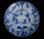 Chinese blue and white basin, Kangxi (1662-1722), decorated with military and equestrian figures, the underside with six panels and foliate sprays to the rim, Chenghua six character mark to the base, diameter: 34cm.