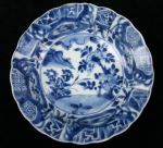 Chinese blue and white 'kraak porselein klapmuts' bowl, Kangxi(1662-1722), decorated in the centre with plants issuing on a river bank, diameter 16cm., condition: faint hairline from rim