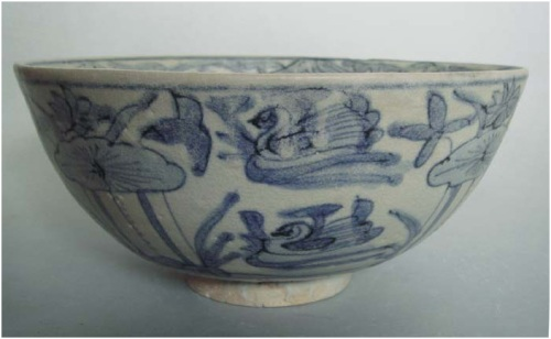 Late Ming Swatow blue and white bowl with duck and lotus    Dia:   19.5   cm.   Good condition with some glaze degradation