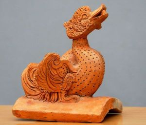 Tượng chim uyên ương thời Trần (TK XIII-XIV).