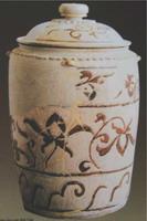 Bình gốm hoa nâu, trưng bày tại bảo tàng Lịch sử – Hà Nội.