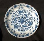 Chinese moulded blue and white saucer dish, mark a Ref: AB3 Chinese moulded blue and white saucer dish, mark and period of Kangxi(1662-1722) decorated with scattered flowers; diameter: 8 in.; 20 cm.; condition: minite nibble.
