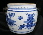 Chinese blue and white food jar, Kangxi(1662-1722) Ref: N907 Chinese blue and white food jar, Kangxi(1662-1722) decorated with two panels of furniture and utensils; with two bronze carrying handles; diameter: 8.1/2 in.; condition: perfect