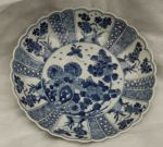 Chinese blue and white plate, Kangxi (1662-1722),  Ref: P488 Chinese blue and white plate, Kangxi (1662-1722), decorated with a bird and chyrsanthemums issuing from rockwork with flowers and blossoms on the border: diameter: 24.5cm. 9 3/4in.