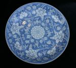 Chinese blue and white circular saucer dish, 18th  Ref: P834 Chinese blue and white circular saucer dish, 18th century, painted with scrolling peony on a blue ground
