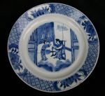 Chinese blue and white plate, Kangxi (1662-1722),  Ref: Q825 Chinese blue and white plate, Kangxi (1662-1722), decorated with a lady seated on a chair reading a scroll with an attendant, the underside with a Kangxi mark within two concentric circles, diameter: 21cm. 8 1/4in. Condition: one chip and one minute frit
