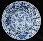 Chinese blue and white moulded dish, Kangxi (1662- Ref: R216 Chinese blue and white moulded dish, Kangxi (1662-1722), decorated with crabs and fish amongst seaweed. Condition: shallow rim chips and firing crack to base. Diameter: 20.7cm, 8 1/8 in.