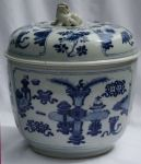 Chinese blue and white bowl and cover, Kangxi (166 Ref: R513 Chinese blue and white bowl and cover, Kangxi (1662-1722), decorated with scholars objects, diameter of lid: 6 7/8in. 17.5cm. Height: 4 1/4in. 10.9cm. condition: restored chips to handles of base and the bottom of one handle remodelled