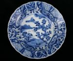 Chinese blue and white 'kraak porselein klapmuts'  Ref: TL44 Chinese blue and white 'kraak porselein klapmuts' bowl, Kangxi(1662-1722), decorated in the centre with plants issuing on a river bank, diameter 16cm., condition