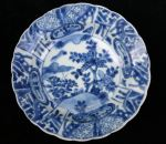 Chinese blue and white 'kraak porselein klapmuts'  Ref: TL46 Chinese blue and white 'kraak porselein klapmuts' bowl, Kangxi(1662-1722), decorated in the centre with plants issuing on a river bank, diameter 16cm., condition: chip and frit