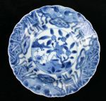Chinese blue and white 'kraak porselein klapmuts'  Ref: TL47 Chinese blue and white 'kraak porselein klapmuts' bowl, Kangxi(1662-1722), decorated in the centre with plants issuing on a river bank, diameter 16cm., condition: frits and two chips