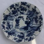 Chinese blue and white decagonal saucer, Kangxi (1 Ref: TL84 Chinese blue and white decagonal saucer, Kangxi (1662-1722), with 4 panels of Long Elizas and 8 panels with flowers, decorated on the back with swirling foliage, diameter: 5 15/16in. 14.7cm. Condition: hairline and tiny frit