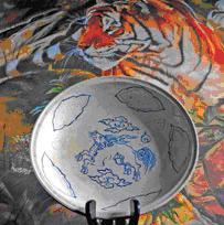 Óc sáng tạo của người thợ gốm thể hiện qua nét vẽ các loài linh thú
